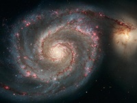The Whirlpool galaxy (M51) and its companion (NGC 5195), a nearby interacting spiral galaxy. <i>Credits: NASA, ESA, S. Beckwith (STScI), and The Hubble Heritage Team (STScI/AURA)</i>